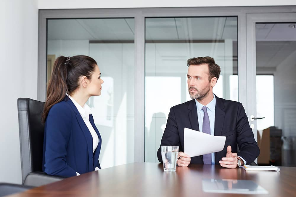 Job interview - recruiter talking with female candidate